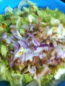 The lettuce and red-onion with the desi-vinaigrette added.